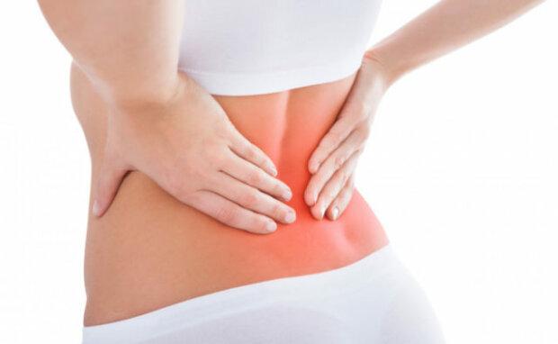 Чому не можна ігнорувати біль в спині при чханні